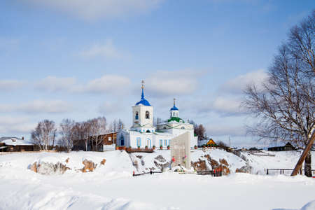 Church of St. George the Victorious in winter in the village of Sloboda, Sverdlovsk region, Russia Stock Photo