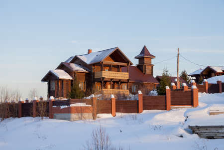Winter rural landscape with a modern wooden house in the village, Sverdlovsk region, Russia