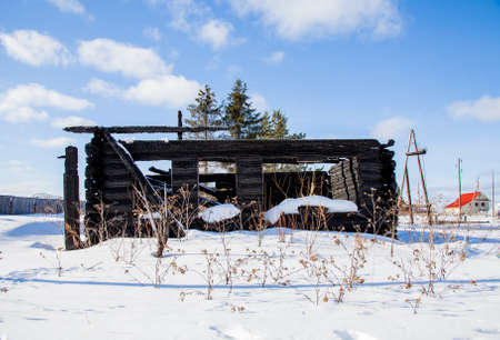 Wooden house after a fire in the village, Sverdlovsk region, Russia
