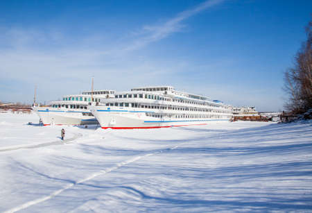 Perm, Russia-March 11.2017: Winter landscape with sailboats in the backwater of frozen river Kama Editorial