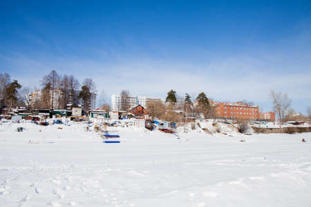 Perm, Russia - March 11.2017: Yacht club in the winter in the backwater of the frozen river Kama