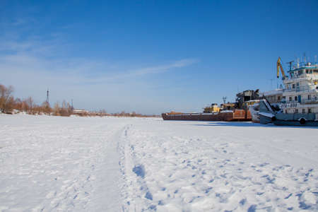 Perm, Russia - March 11.2017: Ships and barges on the shipyard in the backwater of the Kama River in winter