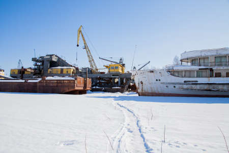 backwater: Perm, Russia - March 11.2017: Ships and barges on the shipyard in the backwater of the Kama River in winter