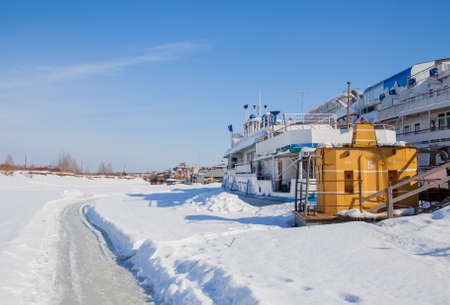 Perm, Russia - March 11.2017: Boats at the shipyard in the backwater of the Kama river in winter