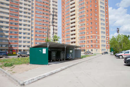 residential area: Perm, Russia - June 13.2017: Garbage bins in the yard of a residential modern complex Editorial