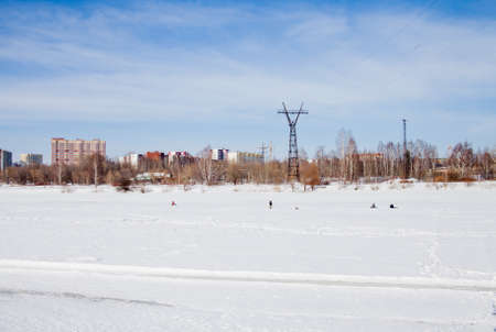 kama: Perm, Russia - March 11.2017: Fishermen catch fish on a frozen river in winter