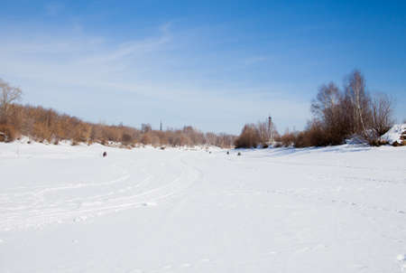 kama: Fishermen catch fish in the winter in the backwater of the frozen Kama river Editorial