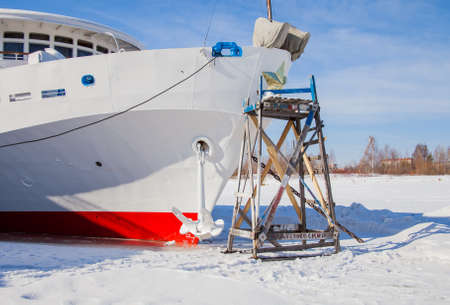 Perm, Russia - March 11.2017: Repair work of a three-deck motor ship at a winter parking in the backwaters of the Kama river