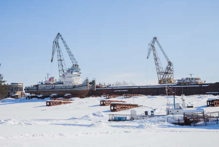 kama: Perm, Russia - March 11.2017: Shipyard in the backwater of the Kama river in winter