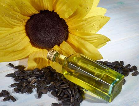 sunflower, sunflower seeds and a bottle of sunflower oil Stock Photo