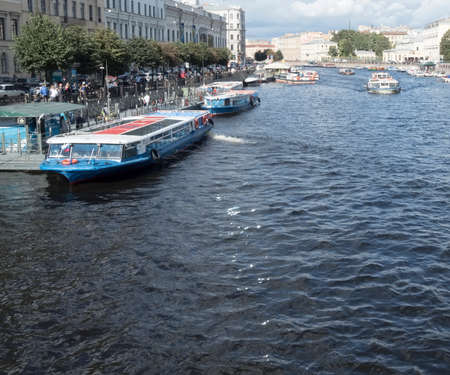 piter: Saint Petersburg, Russia September 10, 2016: Excursion ships in the river of Fontanka. The view from Anichkov bridge in St. Petersburg, Russia.