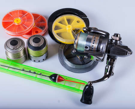 Fishing tackle on a white background not isolated. Reel, fishing line, float