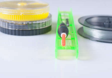 fishing float: Accessories for fishing. Float, fishing line and a box. Focus on the float