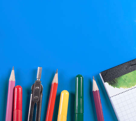 Lying on a white background with school supplies. Stock Photo