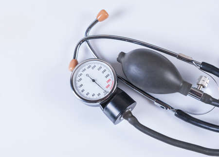 tonometer: Tonometer and stethoscope on white background. Medical equipment