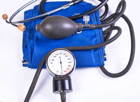 Not isolated sphygmomanometer with blue cuff. Stock Photo