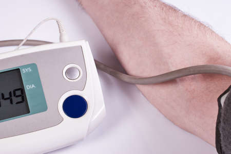 cuff: The arm wearing the cuff of an automatic blood pressure cuff and monitor readings