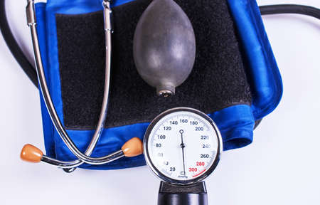 cuff: Sphygmomanometer and stethoscope kit used to measure blood pressure isolated on white