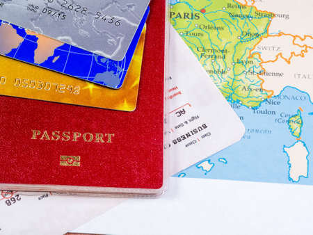 Close-up of various passport, credit cards on a map 스톡 콘텐츠