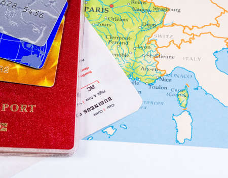Map of the country with a passport and payment cards lying on it