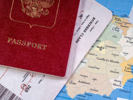 Close-up of a passport with a ticket and a map of Spain. Travel concept Imagens