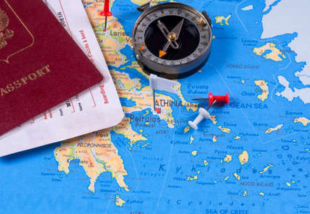 Passport with tickets, compass on a tourist map with pushpins. For travel Stok Fotoğraf