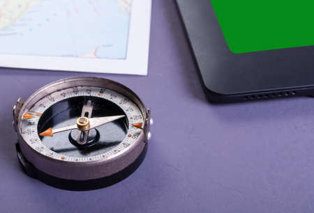 Compass, tablet and map. Travel concept