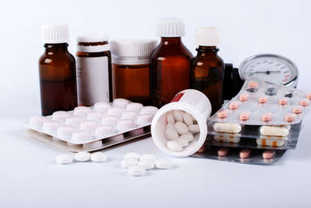 medicines stand on a table light background tablets
