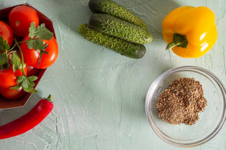 Tomatoes, garlic, red pepper and spices on the kitchen board. Top view, flat lay Stockfoto