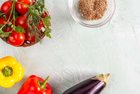 Zucchini, tomatoes, peppers and spices on a blue background. Top view Stockfoto