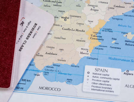 Passport and air ticket on the map of Spain