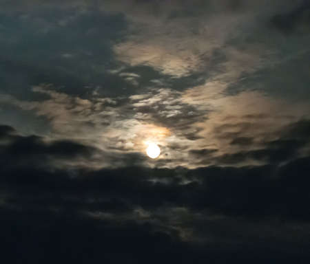 Bright moon in the clouds in the night sky Imagens