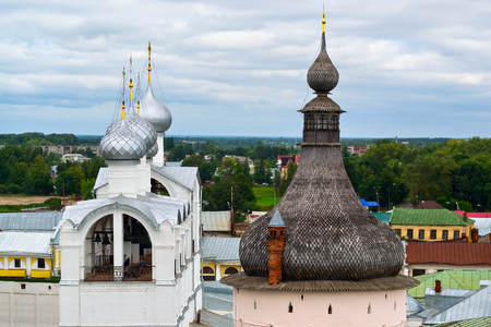 The bell tower in the Kremlin Rostov the Great, view from the observation deck. The man in the distance standing behind.