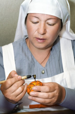 Historical festival River of time , Birsk, Bashkiria Republic, Russia, 30 June 2017. Portrait of sisters of mercy, the first world war. Master class of painting eggs.