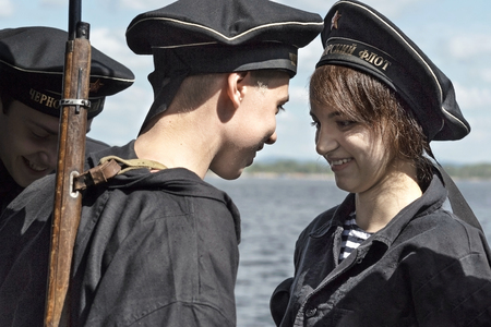navy blue background: Historical festival of the Second World war in Samara to celebrate the Day of the Navy, July 26, 2015. Portrait of a group of Jung in the background of the Volga river.