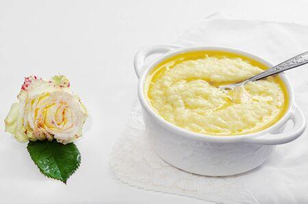 Instant millet porridge for Breakfast, white background. Selective focus Imagens