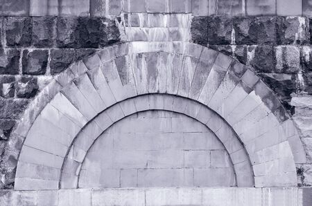 Grey stone background of arched masonry, open. Plenty of room for text
