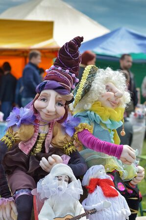 The fair sells creative dolls. Selective focus