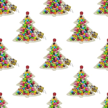 Seamless white background with plate of chocolates in the form of a Christmas tree