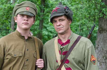 Reconstruction of the events of the Civil war in Russia, Two soldiers of the red army before the battle. Russia, Belgorod 19 may 2018