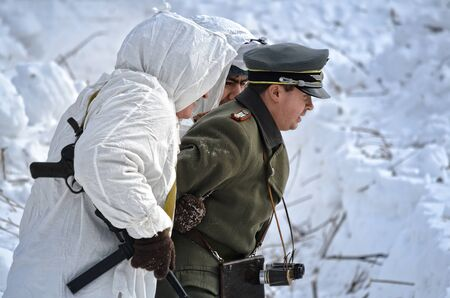 Reconstruction of the events of world war II, red army scouts are a captured German officer. Russia, Samara February 28, 2015.