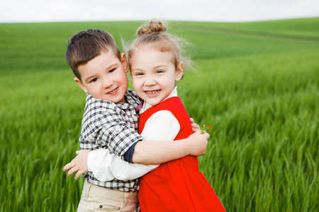 Children in a green field. Stock Photo
