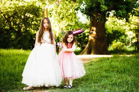 The sisters play princesses.