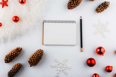 Christmas background with blank notebook, copy space. Template for new year goal or resolutions.Christmas mockup. Flat lay, top view