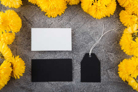 Preparation for creation of a corporate style. Business card and Blank Tag. Flower design, bright yellow color. Mockup.