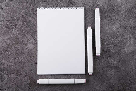Draw in a white notebook. Space for design. Top view.