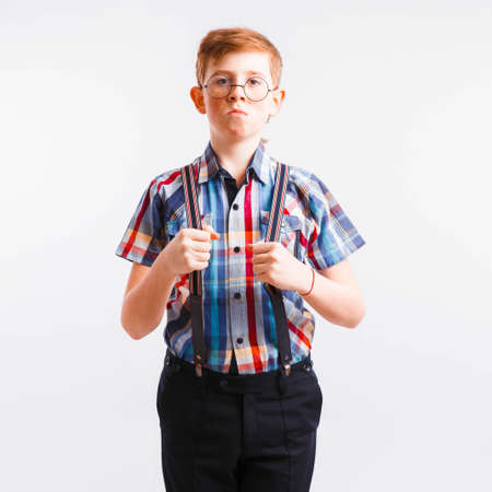 Red-haired nerd with braces and glasses on a white background.