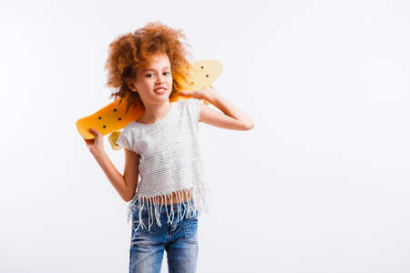 Little girl with curly blond hair on a white background.