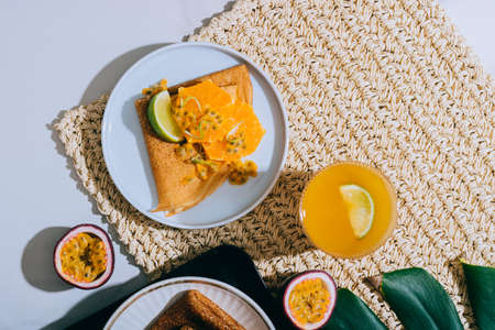 Crepes Or Thin Pancakes With Delicious passion fruit and lime. Summer tropical concept.