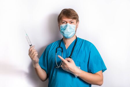Heeling Injection. Senior Grey Hair Doctor In Surgical Mask Holding A Syringe